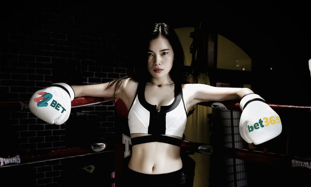 asian girl with boxing gloves in the ring