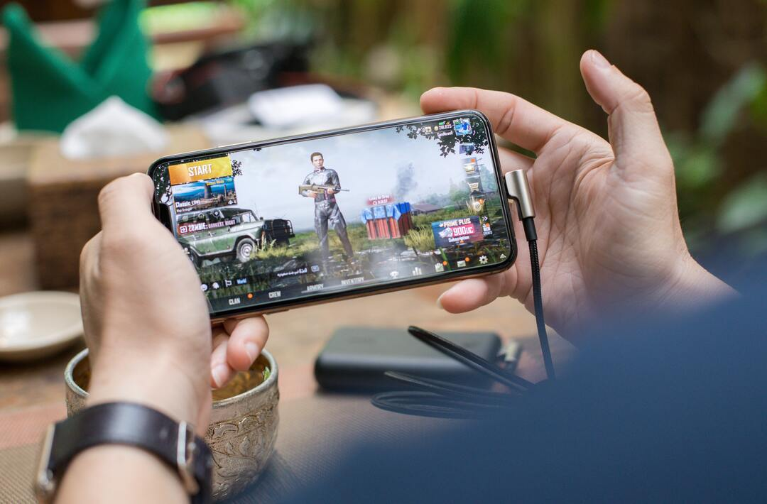 person playing mobile game